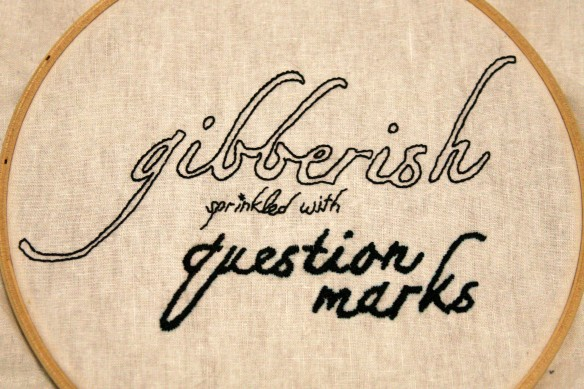 gibberish sprinkled with question marks embroidery