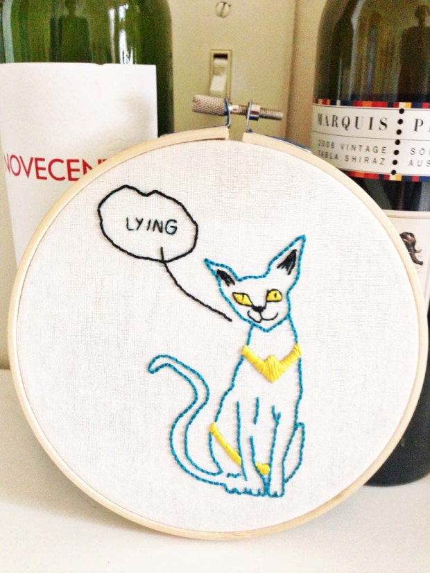 lying cat embroidery