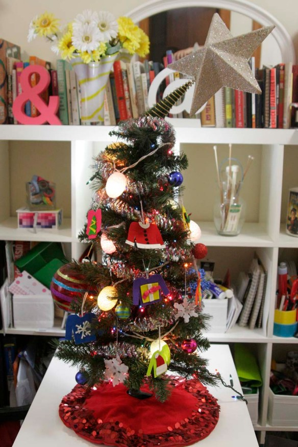 christmas tree with ugly sweater ornaments