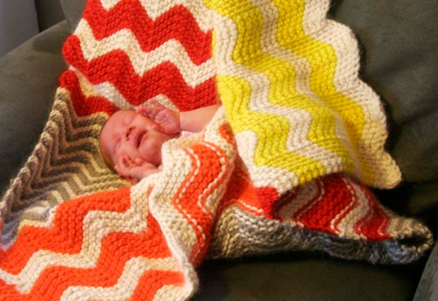 baby nugget in knitted blanket